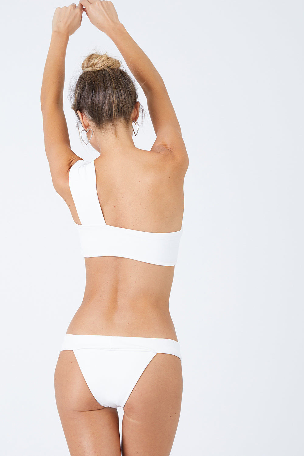 HAIGHT Maria Low-Rise Bikini Bottom - Off-White Bikini Bottom | Off-White| Haight Maria Low Rise Bikini Bottom - Off-White Features:  Low rise briefs Slight cheeky coverage Fits small to size Slips on Back View