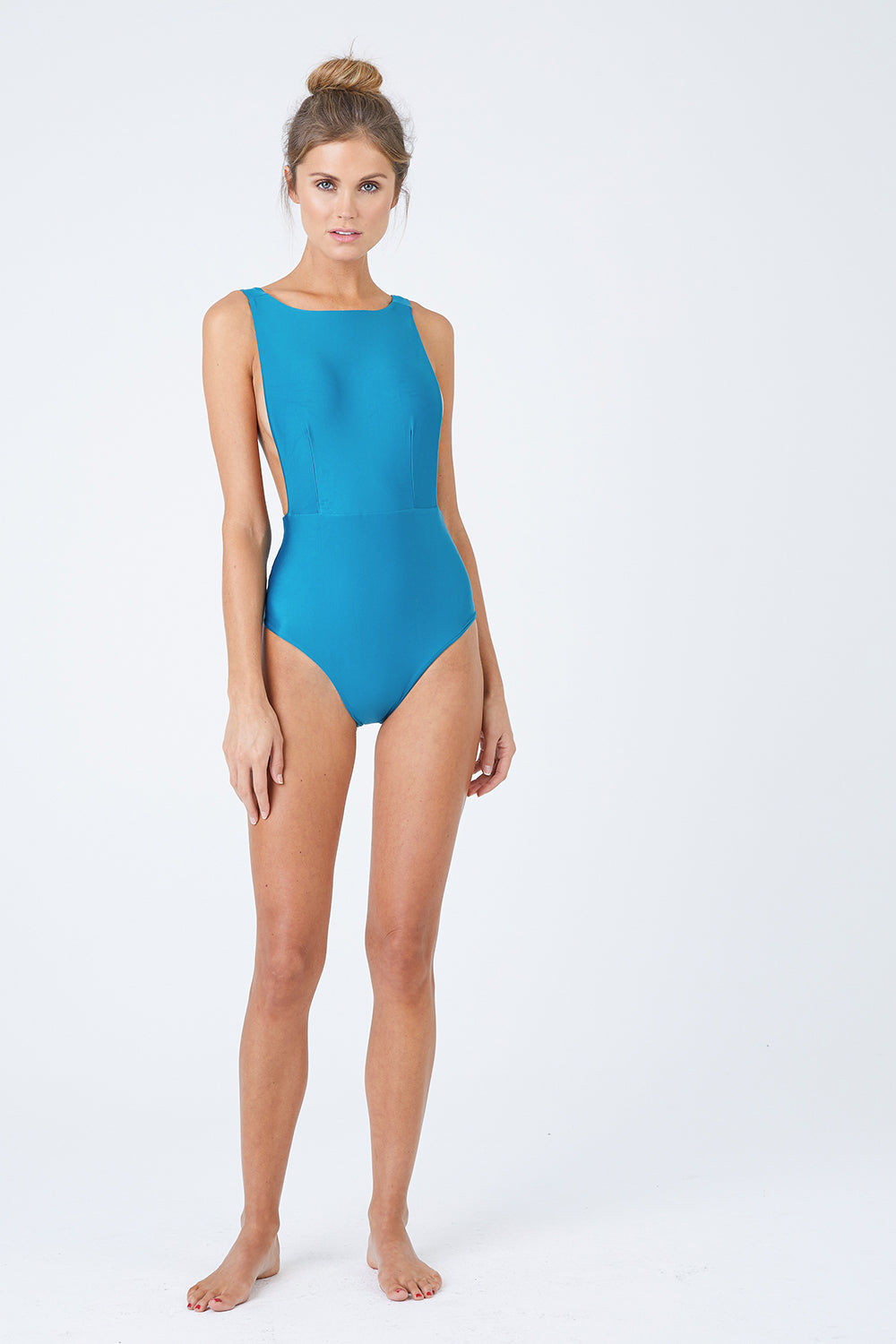 HAIGHT Side Slit Maillot One Piece Swimsuit - Blue Topaz One Piece | Blue Topaz| Haight Side Slit Maillot One Piece Swimsuit - Blue Topaz Features: Crew Neck One Piece Deep sides Detail Scoop Back Thick Back Straps Low Cut Leg Moderate Coverage  Front View