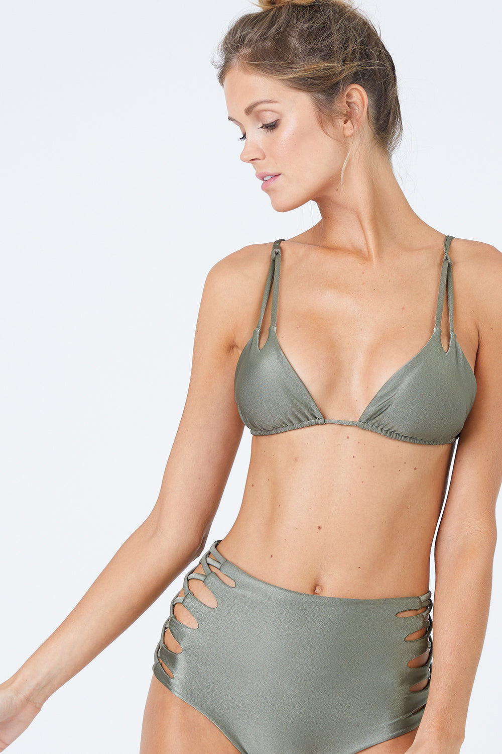 MALAI Lace Up High Waist Bikini Bottom - Sparkly Green Bikini Bottom | Sparkly Green| Malai Malai Lace Up High Waist Bikini Bottom - Sparkly Green Retro style high-waisted bikini bottom in shiny autumn green color. Intricate corset-inspired criss-cross strap detail at sides adds a sexy touch Front View