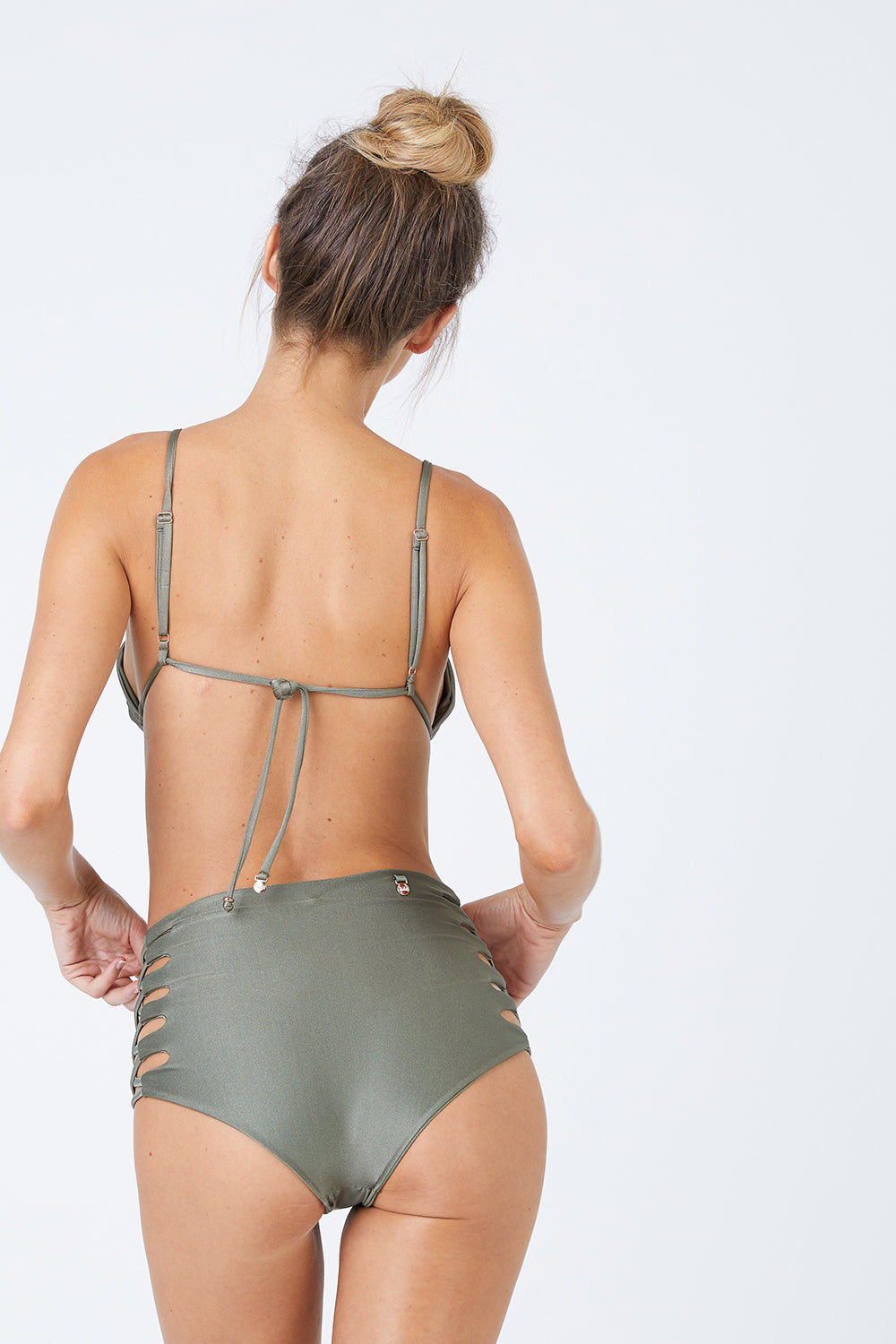 MALAI Lace Up High Waist Bikini Bottom - Sparkly Green Bikini Bottom | Sparkly Green| Malai Malai Lace Up High Waist Bikini Bottom - Sparkly Green Retro style high-waisted bikini bottom in shiny autumn green color. Intricate corset-inspired criss-cross strap detail at sides adds a sexy touch Back View