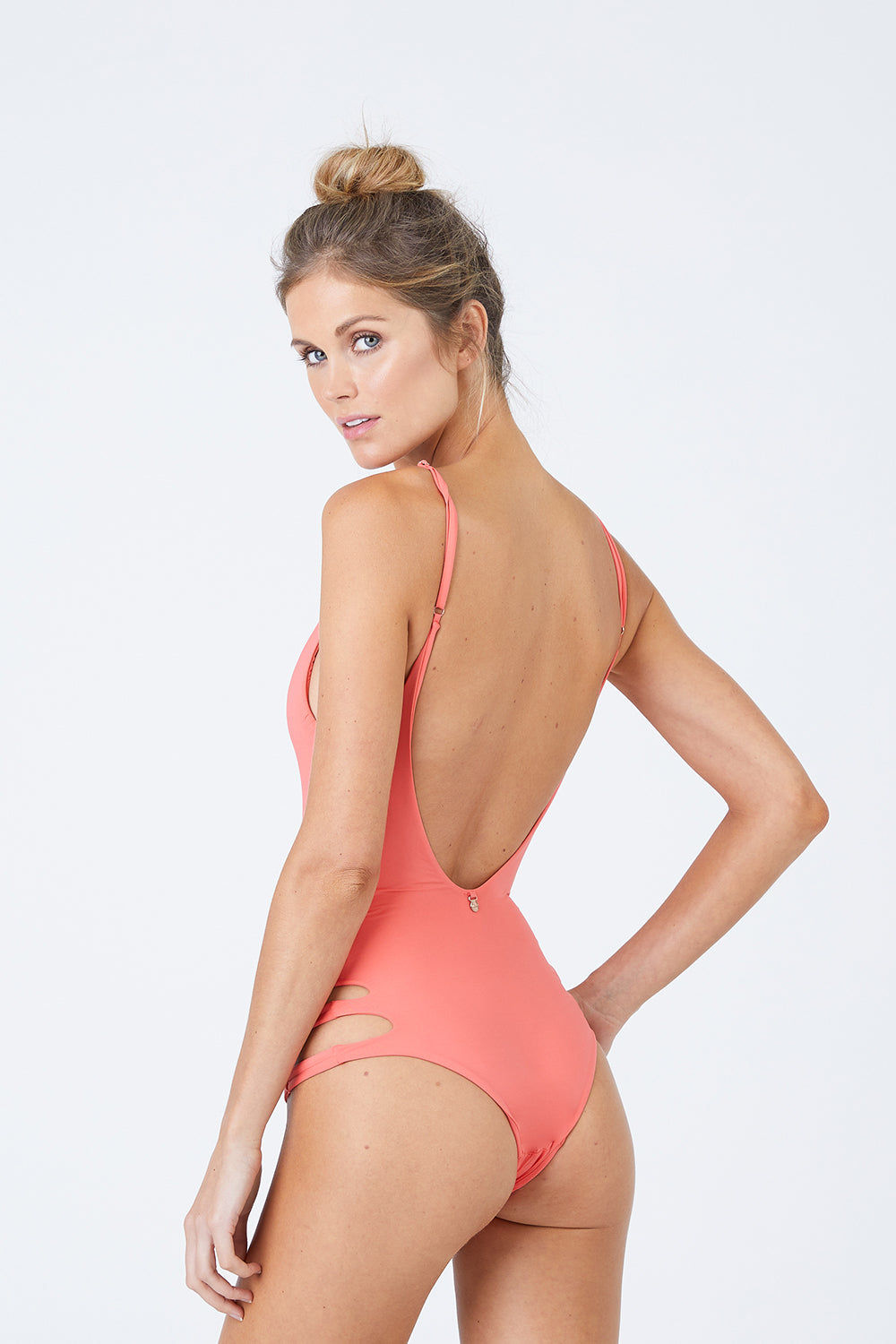 MALAI Sun Crater Side Cut Outs One Piece Swimsuit - Tangerine One Piece | Tangerine| Malai Sun Crater Side Cut Outs One Piece Swimsuit - Tangerine. Features:   Deep V Neckline  Adjustable Shoulder Straps Side Cut Outs  Low Scoop Back  Cheeky-Moderate Coverage Front View