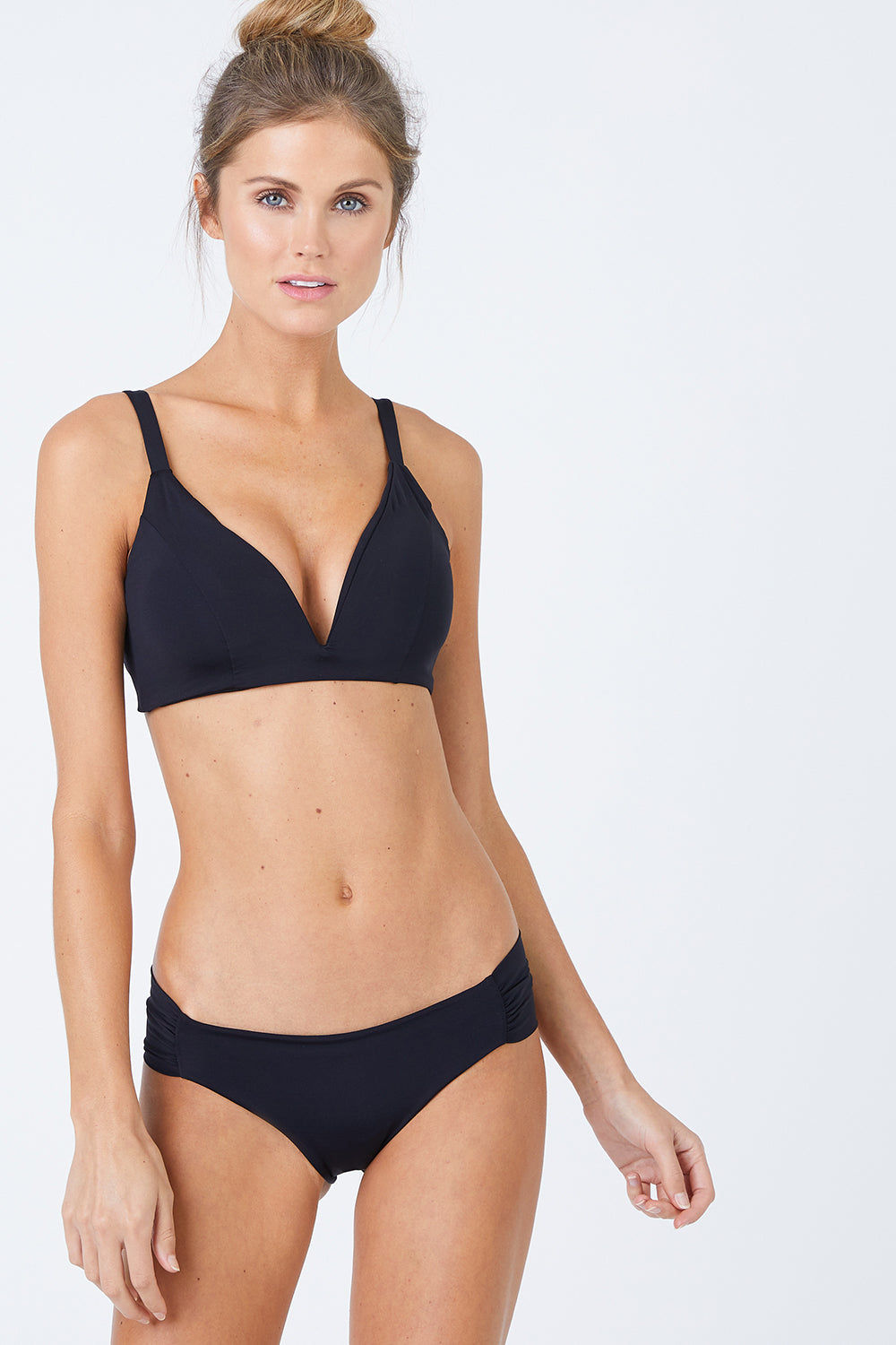 MALAI Ruched Side Bikini Bottom - Black Bikini Bottom | Black| Malai Ruched Side Bikini Bottom - Black. Features:  Low rise hipster Ruched sides Cheeky to moderate coverage Fully lined Front View