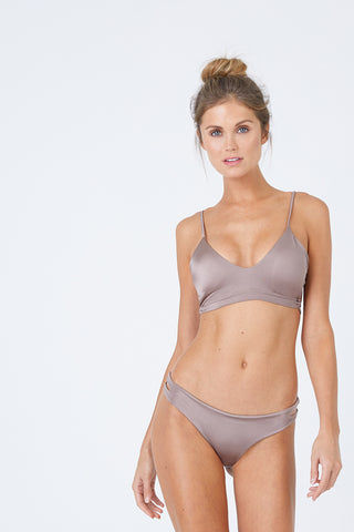 MALAI Cut Out Bikini Bottom - Sparkly Taupe Bikini Bottom | Sparkly Taupe| Malai Cut Out Bikini Bottom - Sparkly Taupe. Features:  Cheeky bikini bottom Cut out sides Front View