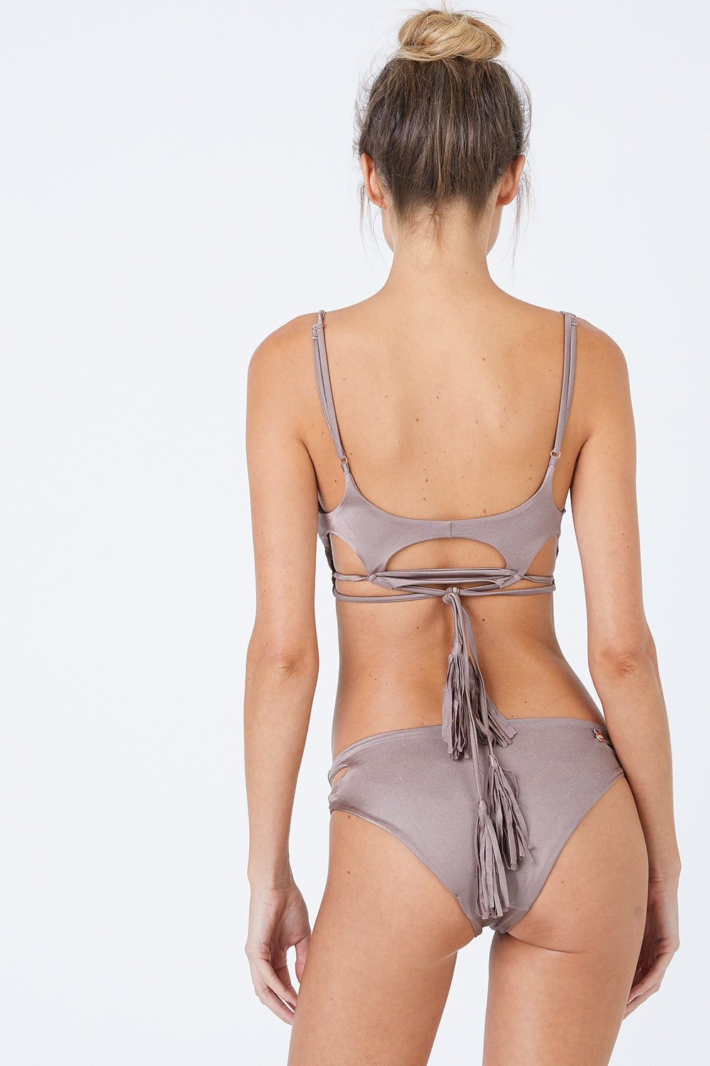 MALAI Cut Out Bikini Bottom - Sparkly Taupe Bikini Bottom | Sparkly Taupe| Malai Cut Out Bikini Bottom - Sparkly Taupe. Features:  Cheeky bikini bottom Cut out sides Back View
