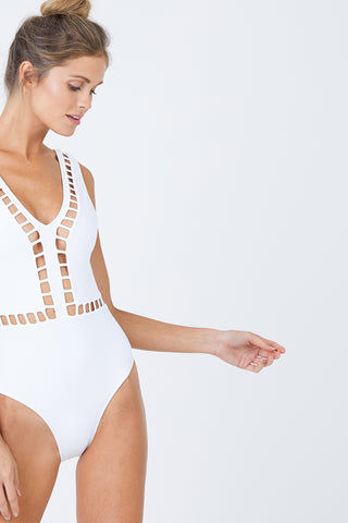 OYE SWIMWEAR Ela Plunge Cut Out High Cut One Piece Swimsuit - White One Piece | White| Oye Swimwear Ela Plunge Cut Out High Cut One Piece Swimsuit - White White deep v-neck one piece swimsuit with cut-out pattern. Wide strap, sleeveless pull-over design features a deep v-shaped back Geometric cut-out high cut leg moderate coverage Front View