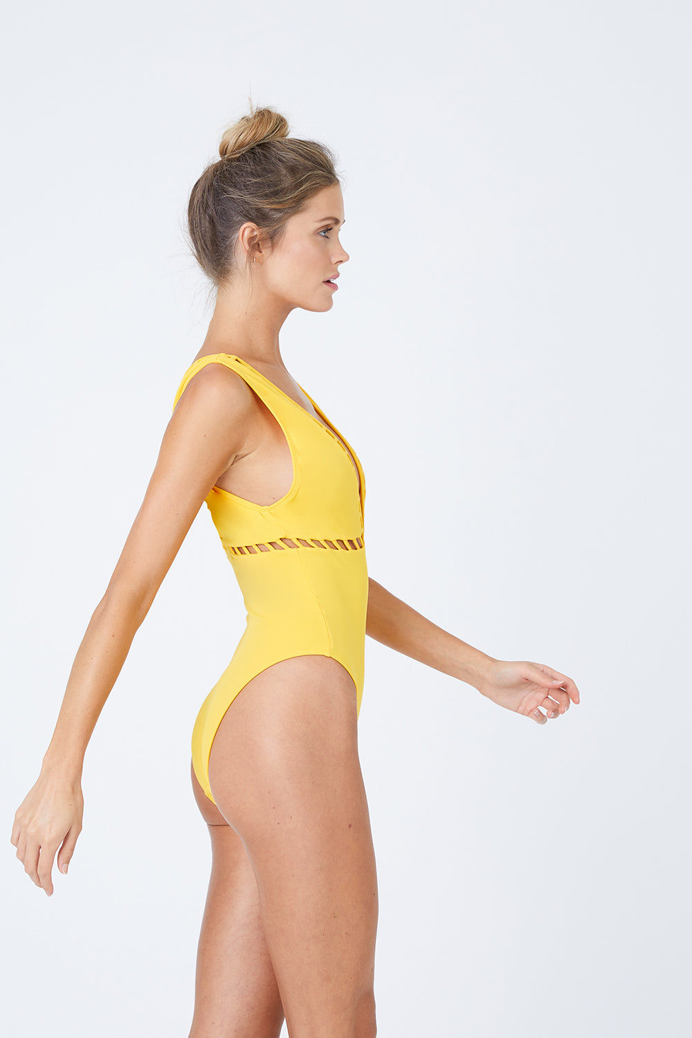OYE SWIMWEAR Ela Plunge Cut Out High Cut One Piece Swimsuit - Yellow One Piece | Yellow| Oye Swimwear Ela Plunge Cut Out High Cut One Piece Swimsuit - Yellow Plunging V Neckline  Cut Out Pattern Detail  Thick Shoulder Straps  High Cut Leg  Moderate Coverage  80% Polyamide, 20%Lycra® Hand wash only Handmade in Istanbul, Turkey High quality Italian material Side View