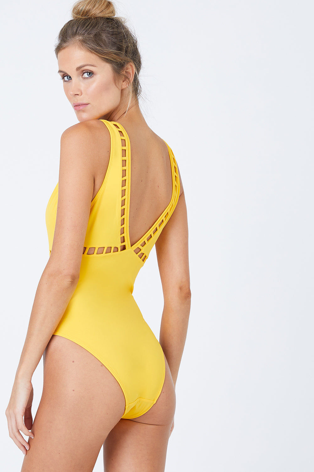 OYE SWIMWEAR Ela Plunge Cut Out High Cut One Piece Swimsuit - Yellow One Piece | Yellow| Oye Swimwear Ela Plunge Cut Out High Cut One Piece Swimsuit - Yellow Plunging V Neckline  Cut Out Pattern Detail  Thick Shoulder Straps  High Cut Leg  Moderate Coverage  80% Polyamide, 20%Lycra® Hand wash only Handmade in Istanbul, Turkey High quality Italian material Back View