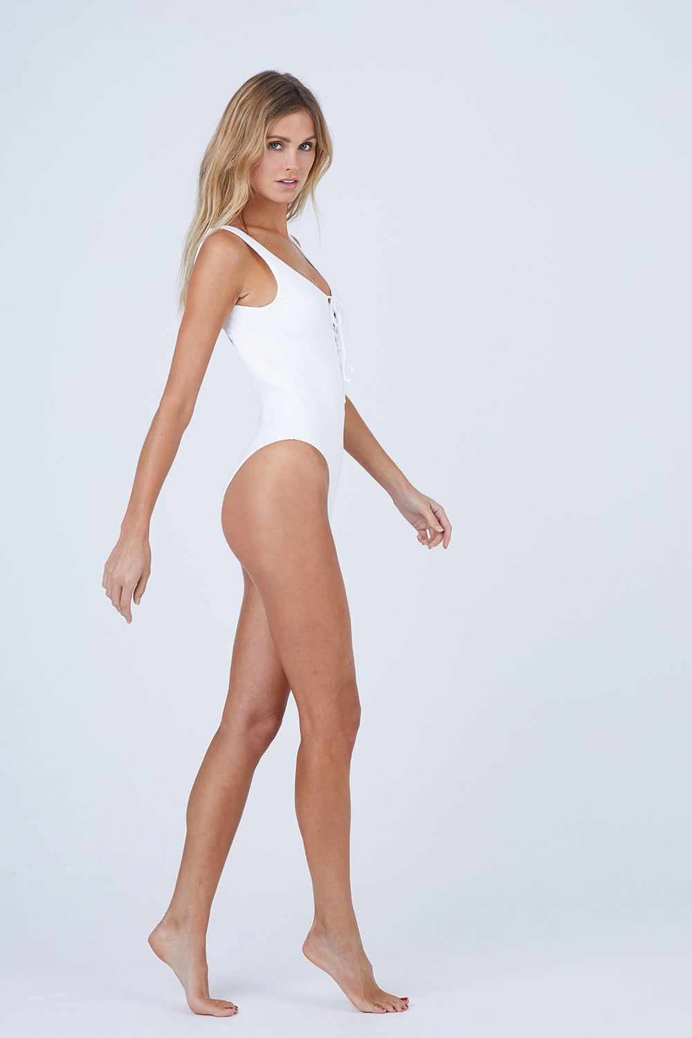 ONIA Bridget Lace Up Front One Piece Swimsuit - Marshmallow Rib One Piece | Marshmallow Rib| Bridget Lace Up Front One Piece Swimsuit - Marshmallow Scoop Neckline Lace Up Front Detail Low Scoop Back Thick Shoulder Straps High Cut Leg Cheeky Coverage Ribbed Fabric  Front View