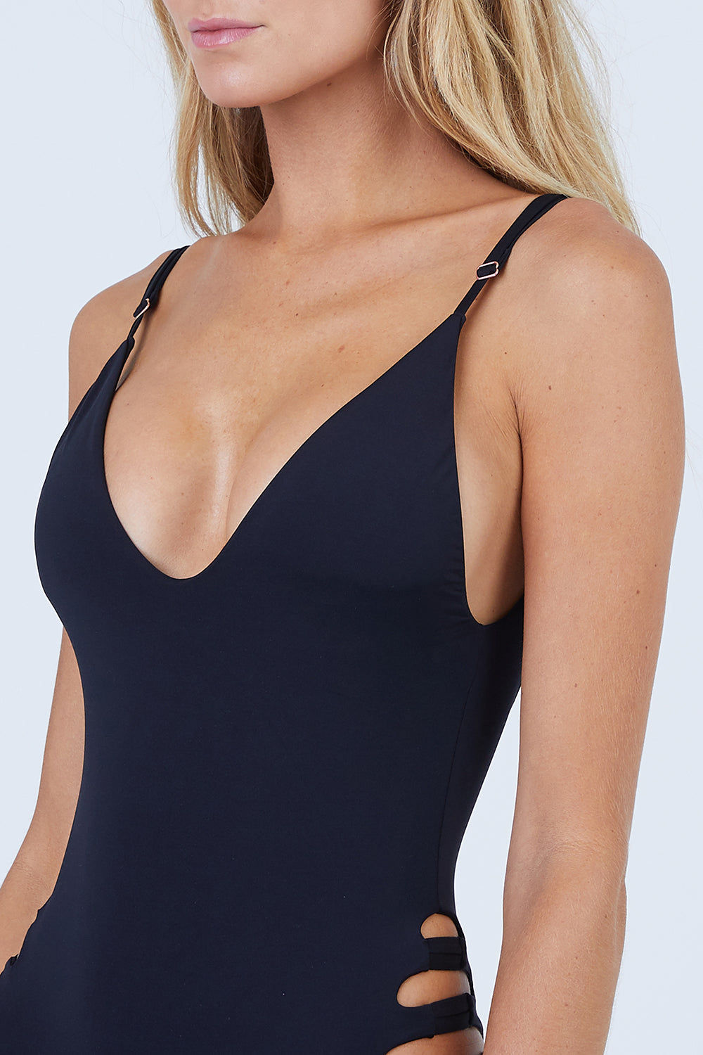 MALAI Sun Crater Side Cut Outs One Piece Swimsuit - Black One Piece | Black| Malai Sun Crater Side Cut Outs One Piece Swimsuit - Black. Features:   Deep V Neckline  Adjustable Shoulder Straps Side Cut Outs  Low Scoop Back  Cheeky-Moderate Coverage Front View