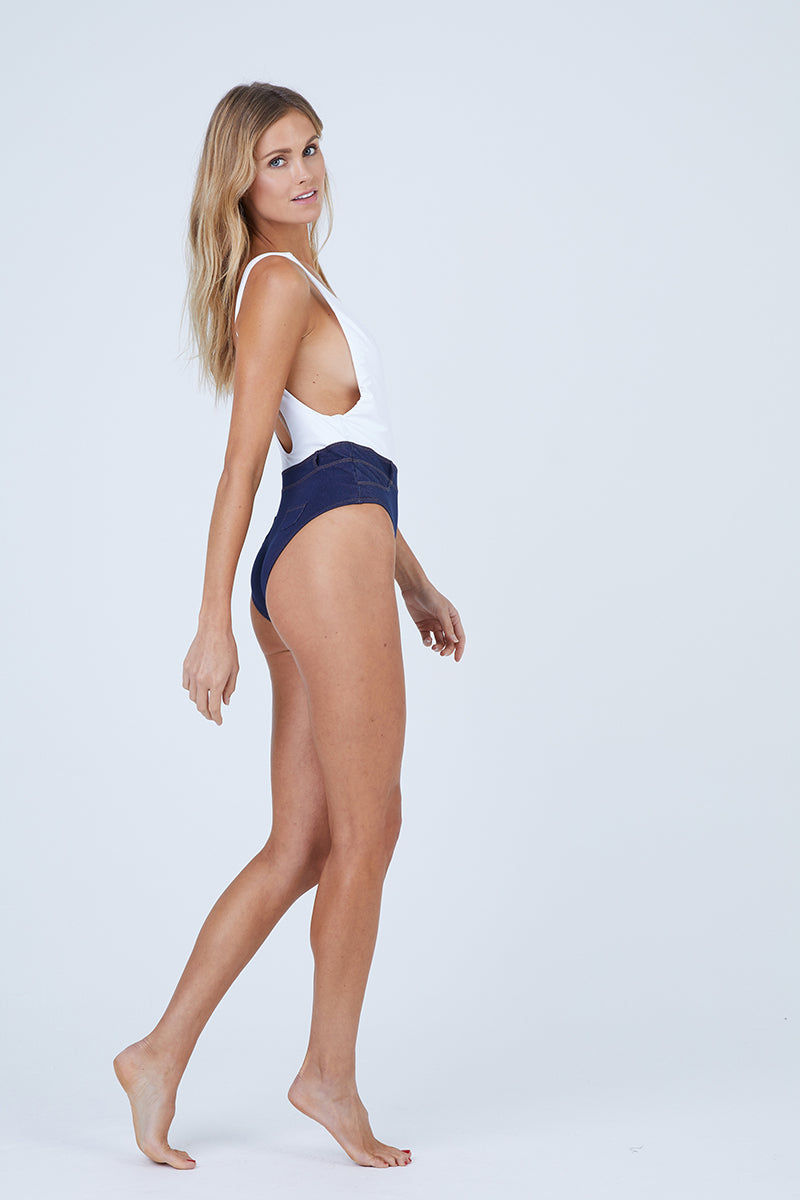 CHLOE ROSE Blue Jean Baby Low Cut One Piece Swimsuit - White/Denim One Piece   White/Denim  Chloe Rose Swimwear Blue Jean Baby Low Cut One Piece Swimsuit - White/Denim. Flat Lay View. .Features:  Low cut clean finish tank top portion High waisted denim inspired bottom portion with a metal button and belt loop details