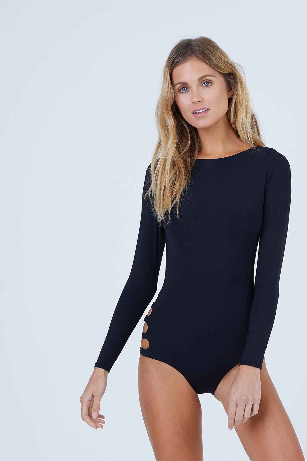 MALAI Long Sleeve Rashguard One Piece Swimsuit - Black One Piece   Black  Malai Long Sleeve One Piece Swimsuit - Black. Features:   Long Sleeves Higher Neckline  Scoop Back High Cut Leg  Cheeky Coverage Front View