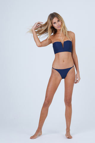 ONIA Rochelle Thin Side Strap Bikini Bottom - Deep Navy Bikini Bottom | Deep Navy| Onia Rochelle Thin Side Strap Bikini Bottom - Deep Navy Features:   Low Rise  Fixed Thin Side Straps  Cheeky Coverage  Ribbed Fabric  Front View