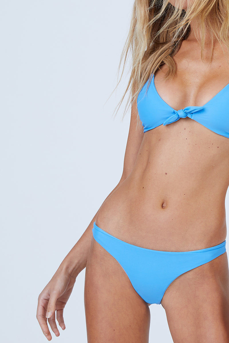 AILA BLUE Cathedral Front Tie Bikini Top - Patriot Blue Bikini Top | Patriot Blue | Aila Blue Cathedral Front Tie Bikini Top - Patriot Blue Front Tie Closure Spaghetti Straps Strappy Back Detail  Self: 80% nylon , 20% spandex Lining: 90% poly , 10% spandex Front View