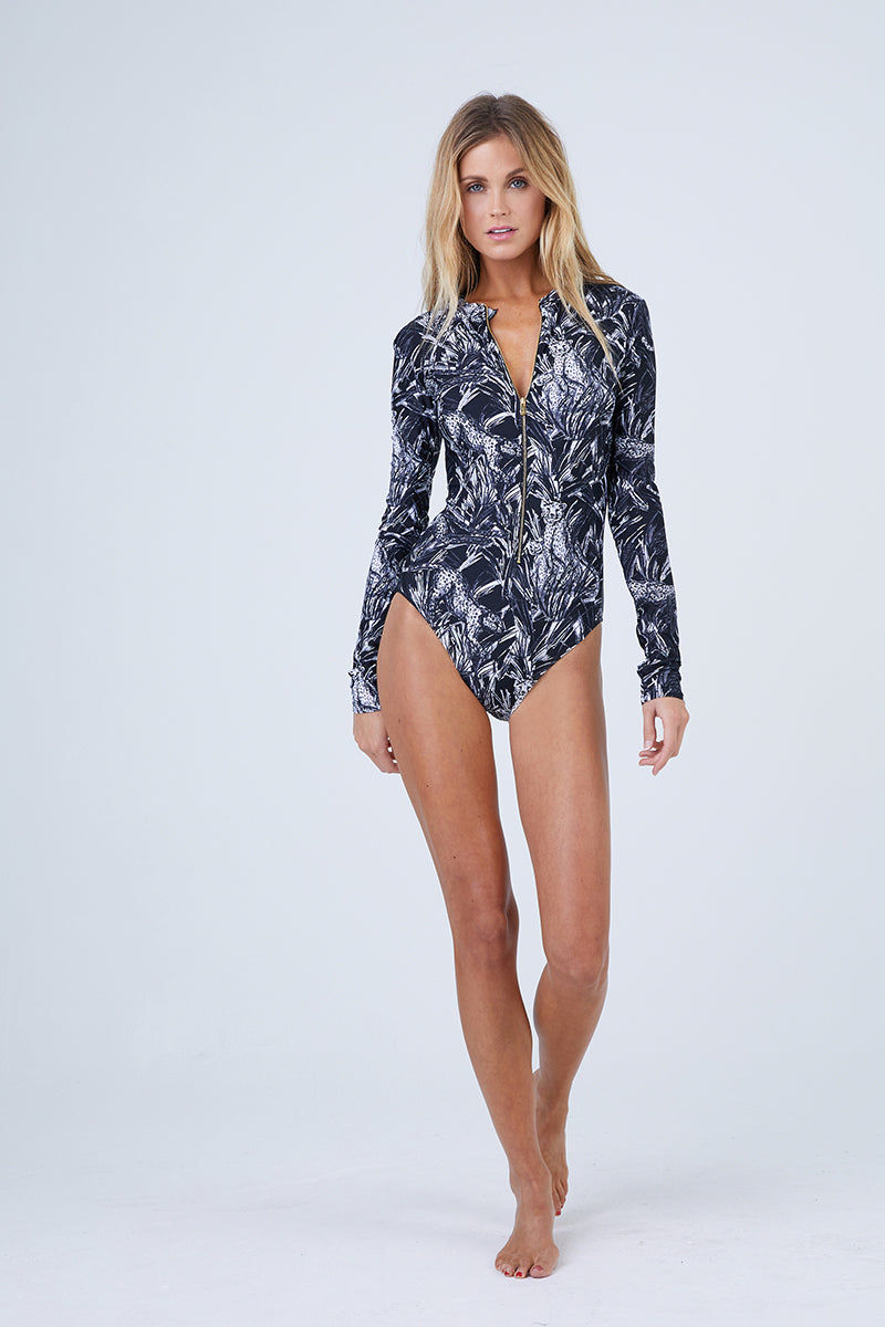 MOTT50 Mila Zipper Front Long Sleeve Rashguard Bodysuit - Lounging Cheetah One Piece |  Lounging Cheetah | Mott 50 Mila Zipper Front One Piece Swimsuit - Lounging Cheetah Features:  UPF 50 Nylon/Spandex Front zip closure Machine Wash/Line Dry Hand Covers for added sun protection Front View