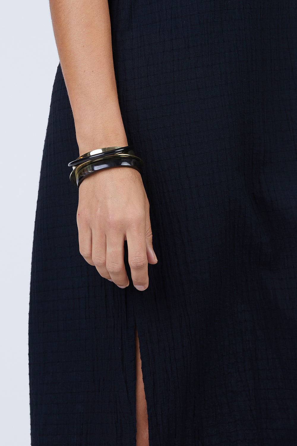 SOKO JEWELRY Stacked Mixed Material Bracelets - Brass/Black Jewelry | Brass/Black| Stacked Mixed Material Bracelets - Brass/Black Brass & black bracelet  Made in Kenya  Front View