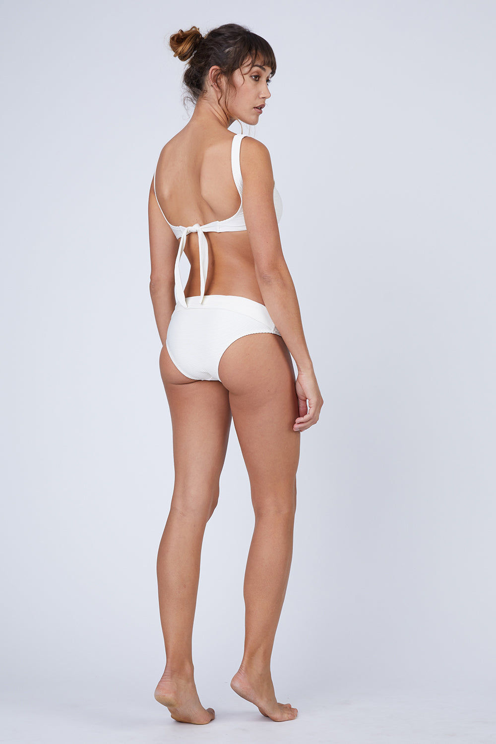 HEIDI KLEIN Fold Over Bikini Bottom - Cream Bikini Bottom | Cream| Heidi Klein Fold Over Bikini Bottom - Cream. Features:  The bottom is cut to be Mid Rise, Mid Coverage. Fully elasticated along legs for a snug fit and to help stay in place when wearer is swimming. Elastic is fully enclosed for a soft, comfortable finish. Fold over detail is stitched in place at the side seam to ensure the correct style shape is maintained when worn – won't need to be adjusted continuously. Front View