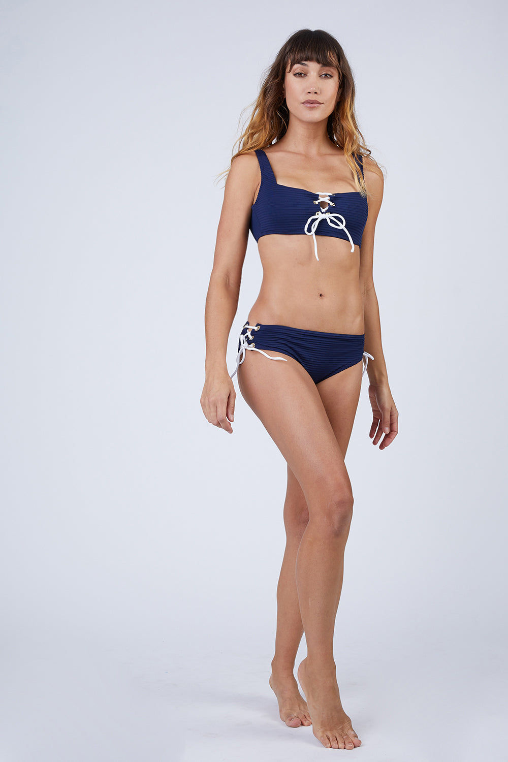 HEIDI KLEIN Ribbed Lace Up Mid Rise Bikini Bottom - Navy Blue Bikini Bottom | Navy Blue| Heidi Klein Ribbed Lace Up Mid Rise Bikini Bottom - Navy Blue. Features:  This style is cut to be High Rise and Mid Coverage. The waist and legs are elasticated for a secure, comfortable fit. Fully lined in soft lining for ultimate comfort. This high waisted style is cut with split side seams, fastened with decorative lacing. Front View