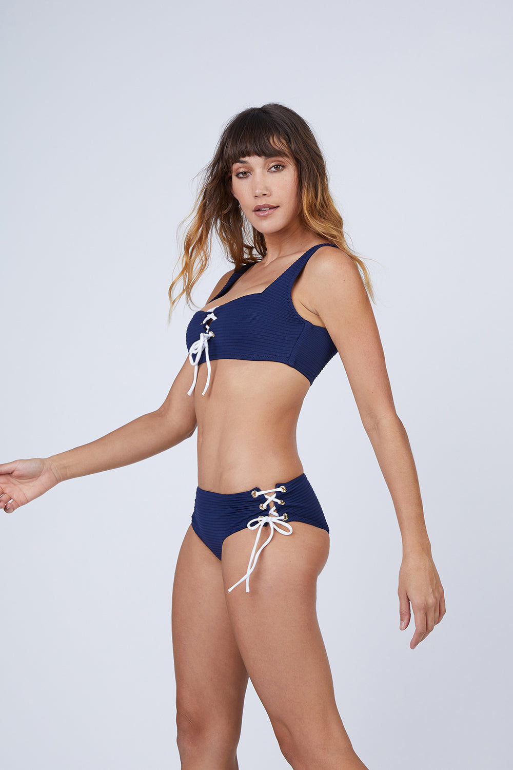 HEIDI KLEIN Ribbed Lace Up Mid Rise Bikini Bottom - Navy Blue Bikini Bottom | Navy Blue| Heidi Klein Ribbed Lace Up Mid Rise Bikini Bottom - Navy Blue. Features:  This style is cut to be High Rise and Mid Coverage. The waist and legs are elasticated for a secure, comfortable fit. Fully lined in soft lining for ultimate comfort. This high waisted style is cut with split side seams, fastened with decorative lacing. Side View