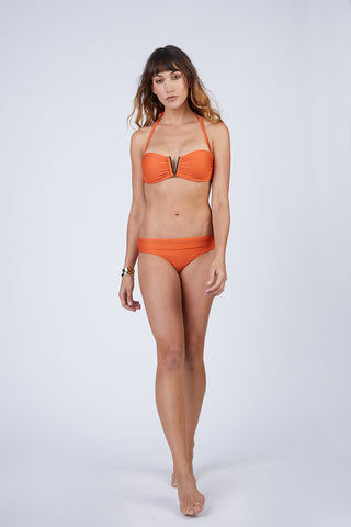 HEIDI KLEIN Fold Over Bikini Bottom - Orange Bikini Bottom | Orange| Heidi Klein Fold Over Bikini Bottom - Orange. Features:  The bottom is cut to be Mid Rise, Mid Coverage. Fully elasticated along legs for a snug fit and to help stay in place when wearer is swimming. Elastic is fully enclosed for a soft, comfortable finish. Fold over detail is stitched in place at the side seam to ensure the correct style shape is maintained when worn – won't need to be adjusted continuously.Front View