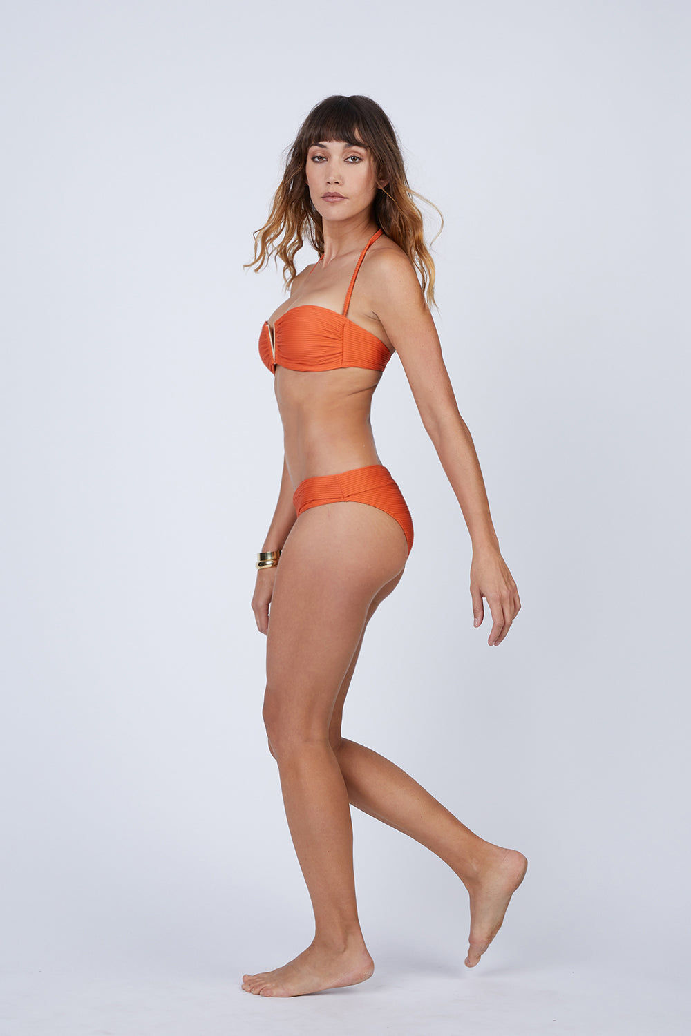 HEIDI KLEIN V Padded Bandeau Bikini Top - Orange Bikini Top | Orange| heidi klein V Padded Bandeau Bikini Top - Orange. Features:  Constructed with elastic stitched at neckline and bottom of cradle and boning at side seam to support cup. Removable, light foam padding. Enclosed elastic along neckline and bottom of cups to provide a close fit. Style is offered with a clasp back fastening, which locks and clicks shut into place to provide much better security. Always offered with removable halter neck straps for alternative styling and extra support. Front View
