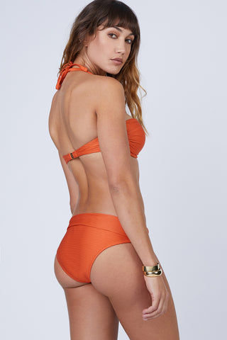 HEIDI KLEIN Fold Over Bikini Bottom - Orange Bikini Bottom | Orange| Heidi Klein Fold Over Bikini Bottom - Orange. Features:  The bottom is cut to be Mid Rise, Mid Coverage. Fully elasticated along legs for a snug fit and to help stay in place when wearer is swimming. Elastic is fully enclosed for a soft, comfortable finish. Fold over detail is stitched in place at the side seam to ensure the correct style shape is maintained when worn – won't need to be adjusted continuously.Back View