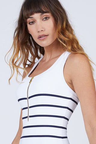 HEIDI KLEIN Racerback One Piece Swimsuit - Nautical Stripe Print One Piece | Nautical Stripe Print| Heidi Klein Racerback One Piece Swimsuit - Nautical Stripe. Features:  Internal shelf bra provides hidden support and has boning at side seam for extra support. The neckline, armholes and legs are trimmed with bonded fabric for a clean finish. This swimsuit has sporty styling with a scoop neckline and racerback, making it ideal for swimming and water sports activities. This piece is finished with our signature shiny zip at the front for a sports luxe look. Front View