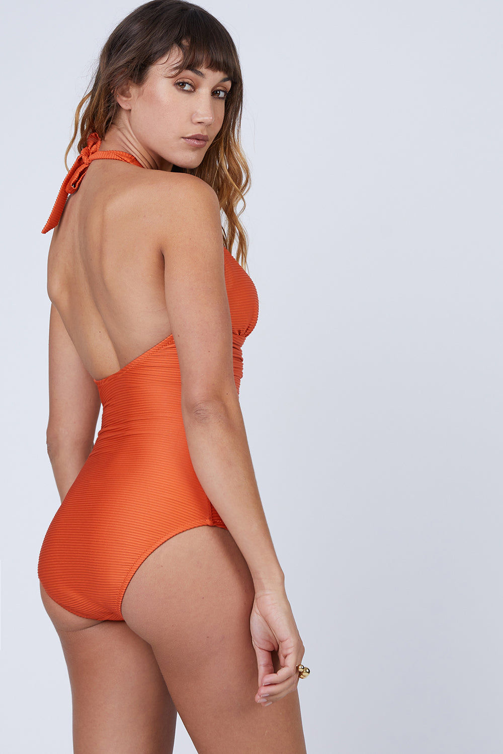HEIDI KLEIN Ribbed Halter V Bar One Piece Swimsuit - Orange One Piece | Orange| Heidi Klein V Bar One Piece Swimsuit - Orange. Features:  Removable internal foam cups give good shaping with internal underband for further support. There is soft boning in the side seam and light removable padding at the bust. The Heidi Klein bespoke V Bar hardware at the centre front subtly draws attention to the bust. Neckline, underarm, back and legs have hidden elastic for secure fit and halterneck ties allow for adjustable fit. Front View