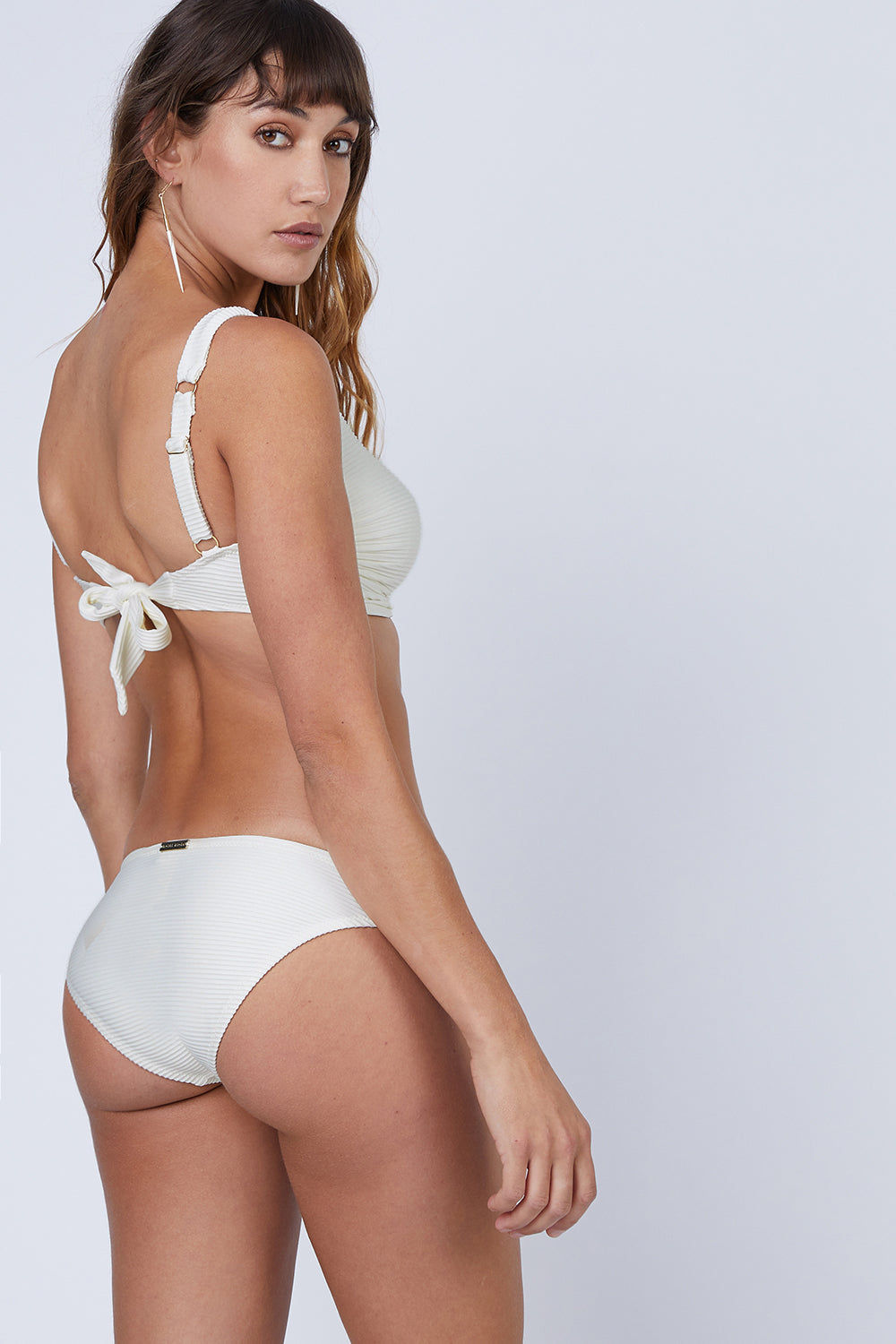 HEIDI KLEIN D-G Rectangle Bikini Top - Cream Bikini Top | Cream| heidi klein D-G Rectangle Bikini Top - Cream. Features:  Hardware at centre front and bone at side seam help with support and provide a luxurious finish. Underwired. The side seams and underarm coverage  provide support The bust is lined with sculpting fabric and the cradle is additionally lined in powermesh, thus making the top very supportive The bottom band ties are an adjustable tie back. The shoulder straps are adjustable in length and elasticated for comfort. Back View
