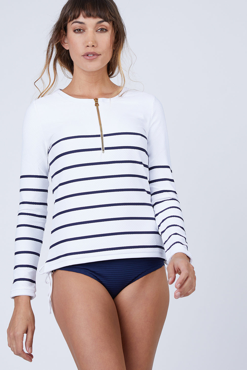 HEIDI KLEIN Zipper Front Long Sleeve Rashguard - Nautical Stripe Print Bikini Top | Nautical Stripe Print | Heidi Klein Rash Vest - Nautical Stripe. Features:  Rash vests in block colors and slimline stripes swimsuits Impeccably cut for a flattering fit from technically advanced textured fabric Finished with beautifully weighted hardware Composition: 85% Polyamide 15% Elastane Front View