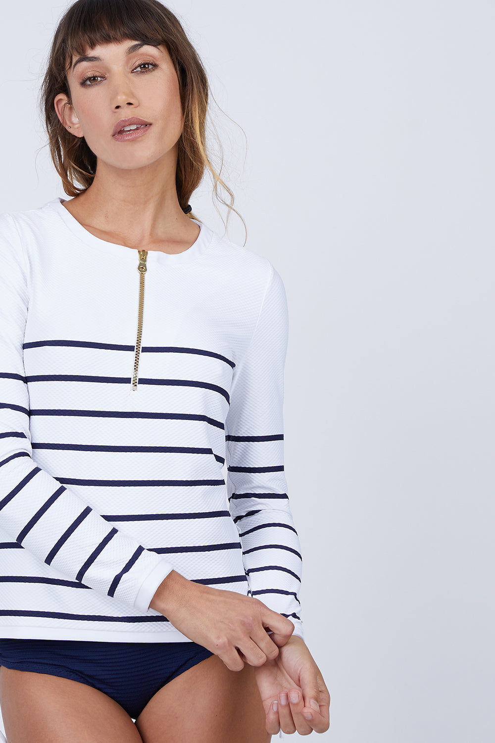 HEIDI KLEIN Zipper Front Long Sleeve Rashguard - Nautical Stripe Print Bikini Top | Nautical Stripe Print | Heidi Klein Zipper Front Long Sleeve Rashguard - Nautical Stripe Print  Features:  Rash vests in block colors and slimline stripes swimsuits Impeccably cut for a flattering fit from technically advanced textured fabric Finished with beautifully weighted hardware Composition: 85% Polyamide 15% Elastane Front View