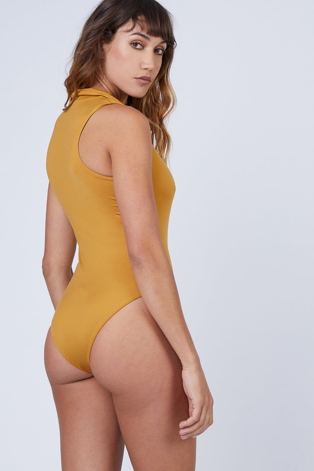 AMAIO SWIM Collette Plunging One Piece Swimsuit - Gold One Piece | Gold| Amaio Collette One Piece-Black| Amaio Swim Colette Plunging One Piece Swimsuit - Features: Collared. Plunging deep-V neck. Medium coverage.