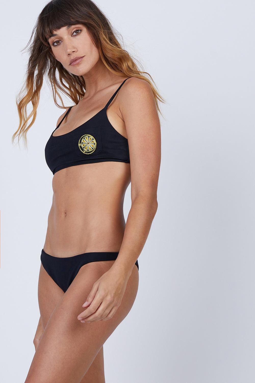 AMAIO SWIM Irina Classic Bralette Bikini Top - Black Bikini Top | Black| Amaio Swim Irina Classic Bralette Bikini Top - Black Features:  Soft, luxe rib fabric Bralette Lemon- embroidered patch. Front View