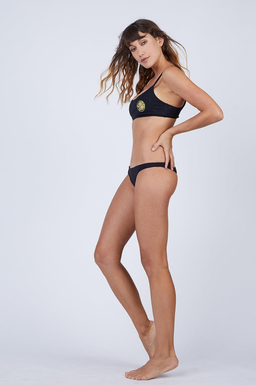 AMAIO SWIM Irina Classic Bralette Bikini Top - Black Bikini Top | Black| Amaio Swim Irina Classic Bralette Bikini Top - Black Features:  Soft, luxe rib fabric Bralette Lemon- embroidered patch. Back  View