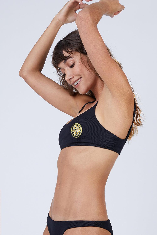 AMAIO SWIM Irina Classic Bralette Bikini Top - Black Bikini Top | Black| Amaio Swim Irina Classic Bralette Bikini Top - Black Features:  Soft, luxe rib fabric Bralette Lemon- embroidered patch. Side  View