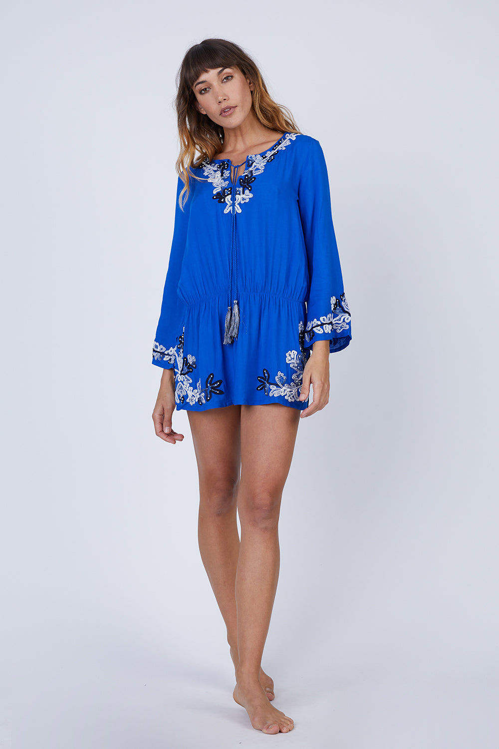 AMITA NAITHANI Floral Crush Dress - Blue Dress | Blue| Amita Naithani Floral Crush Dress - Blue. Floral embroidered dress Long sleeves Front tie closure with tassel detail Rayon modal 100% Rayon Hand wash Front View