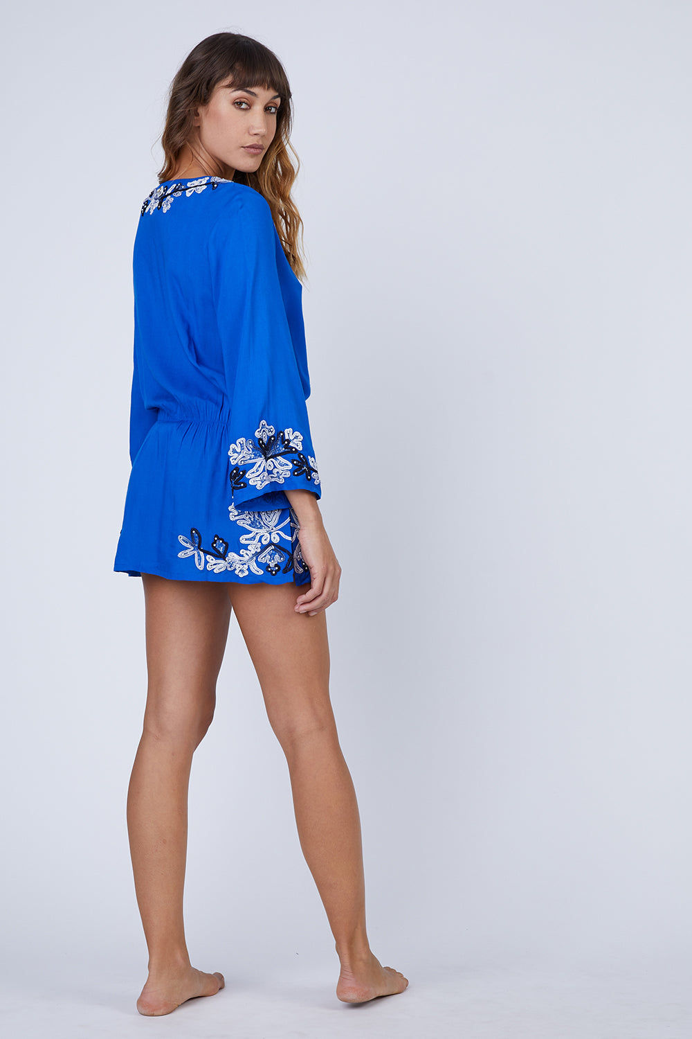 AMITA NAITHANI Floral Crush Dress - Blue Dress | Blue| Amita Naithani Floral Crush Dress - Blue. Floral embroidered dress Long sleeves Front tie closure with tassel detail Rayon modal 100% Rayon Hand wash Back View