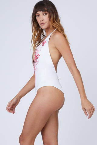 AMITA NAITHANI Floral Crush Plunging One Piece Swimsuit - White & Tea Rose One Piece | White & Tea Rose| Amita Naithani Floral Crush Plunging One Piece Swimsuit - White W/ Tearose. Features:  Plunging neckline The deep V-neckline plunges down to the mid-torso area to frame and flatter your décolletage. Vibrant abstract embroidery  Hand wash Front View