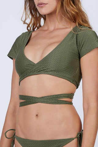 ROSA CHA Transpasse Crop Wrap Bikini Top - Olive Green Bikini Top | Olive Green| Rosa Cha Transpasse Crop Wrap Bikini Top - Olive Green  V Neckline  Short Sleeves Wrap Style Back Cut Out Detail Perforated Lycra  88% Viscose 12% Polyamide / Lining: 84% Polyamide 16% Elastane Front View