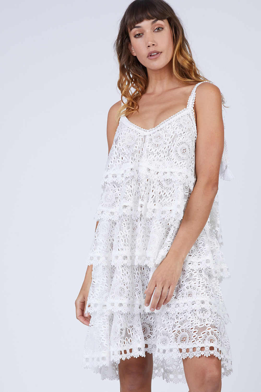 WAIMARI Audrey Tiered Ruffle Lace Sundress - Ivory White Dress | Ivory White| Waimari Audrey Tiered Ruffle Lace Sundress - Ivory White Lace dress V neckline  Ruffle tiers Shoulder ties with tassel ends  Front View