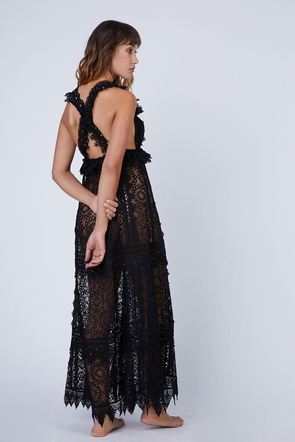 WAIMARI Chic Escape Sheer Lace Maxi Dress - Black Dress | Black| Waimari Chic Escape Sheer Lace Maxi Dress - Black Maxi dress V neckline  criss cross back straps All over lace detail  Ruffle detail Back View