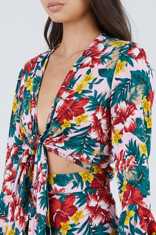 XIX PALMS Hana Bell Sleeves Front Knot Crop Top - Vibrant Floral Print Top | Vibrant Floral Print | XIX Palms Hana Bell Sleeves Front Knot Crop Top - Vibrant Floral Print Retro long bell sleeve V-neck front knot top in a vibrant tropical floral print. The seductive deep V-neckline pairs perfectly with pendant or lariat necklaces while showing off your décolletage. Adjustable front knot tie Front View