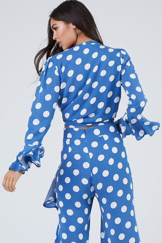 XIX PALMS Beverly Hills Tourista High Waist Pants - Blue & White Polka Dot Print Pants | Blue & White Polka Dot Print| XIX Palms Beverly Hills Tourista High Waist Pants - Blue & White Polka Dot Print Royal blue high-waisted cropped flare pants with a bright white polka dot print. Back View