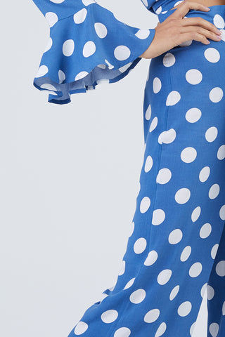 XIX PALMS Beverly Hills Tourista High Waist Pants - Blue & White Polka Dot Print Pants | Blue & White Polka Dot Print| XIX Palms Beverly Hills Tourista High Waist Pants - Blue & White Polka Dot Print Royal blue high-waisted cropped flare pants with a bright white polka dot print. Side View