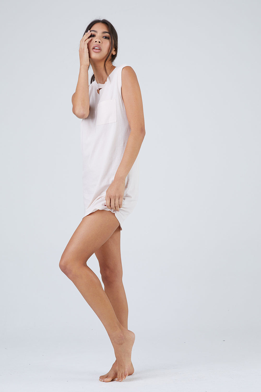 N:PHILANTHROPY Shot High Neck Mini Dress - Petal Pink Dress | Petal Pink| N:PHILANTHROPY Shotgun High Neck Mini Dress - Petal Pink. Features:  High neckline with cutout detail Raw edge cap sleeves 100% Cotton jersey Machine wash cold like colors, lay flat to dry Made in LA Front View