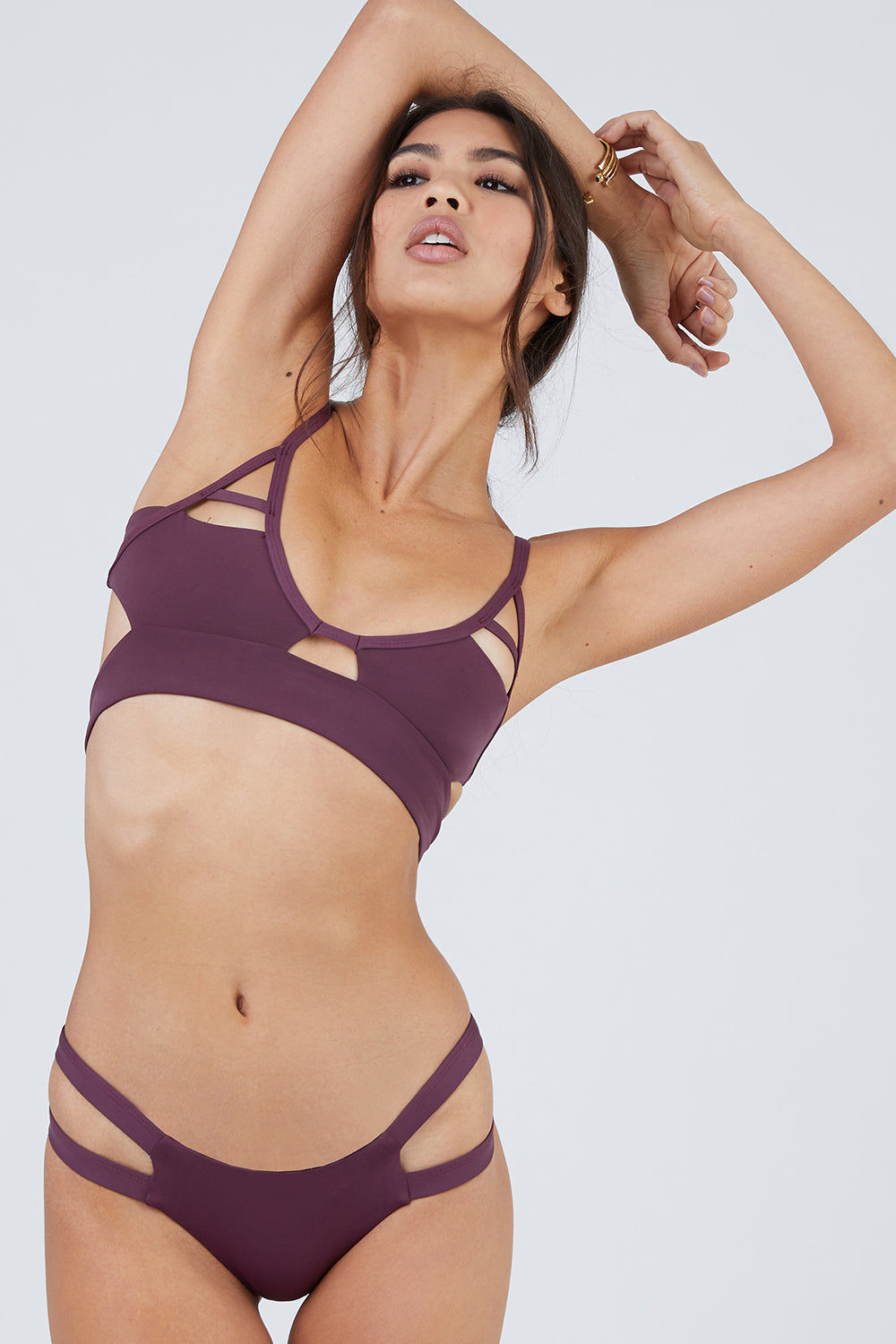TAVIK Jessi Cut Out Triangle Bikini Top - Merlot Bikini Top | Merlot| Tavik Jessi Cut Out Triangle Bikini Top - Merlot V-neck fixed cut out triangle bralette seamless bikini top in merlot purple. Front cut-outs expose some skin and create a sporty look. Wide underbust band provides extra support for your bust. Adjustable spaghetti straps Front View