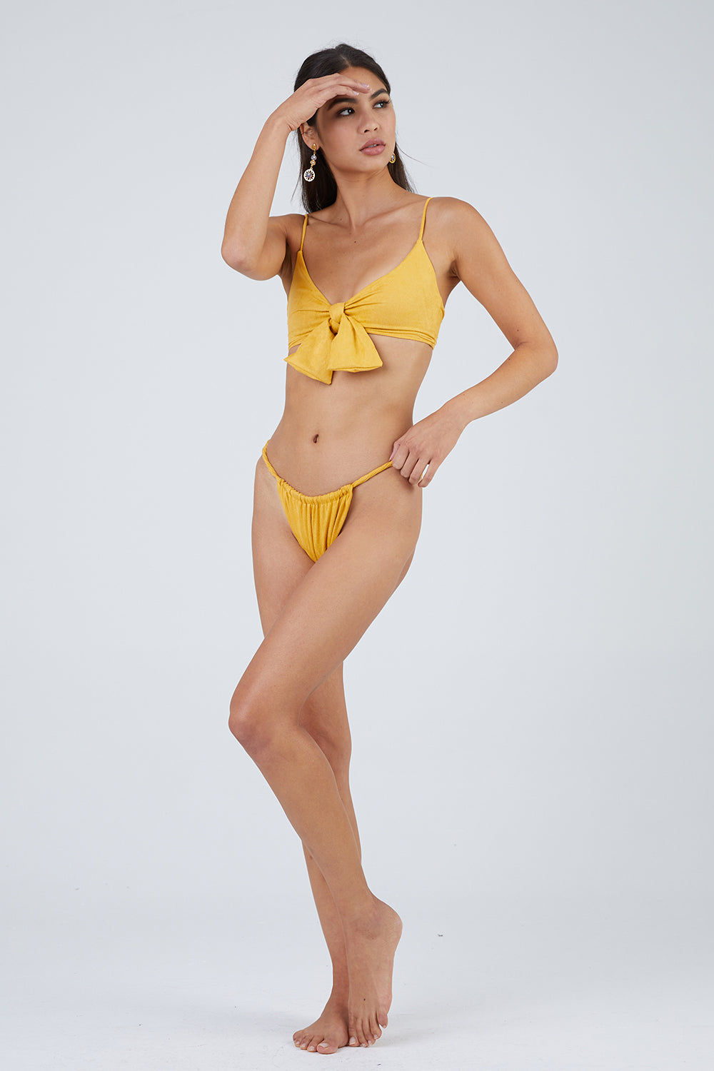 MONICA HANSEN BEACHWEAR Start Me Up Front Scrunch Bikini Bottom - Yellow Suede Bikini Bottom | Yellow Suede| Monica Hansen Start Me Up Front Scrunch Bikini Bottom - Yellow Suede Scrunch detail in front and U shaped back High cut leg Cheeky coverage Double fabric on the inside instead of lining Italian fabric 85% Nylon 15% Elastane Manufactured in Italy Hand wash cold.  Dry flat Front View