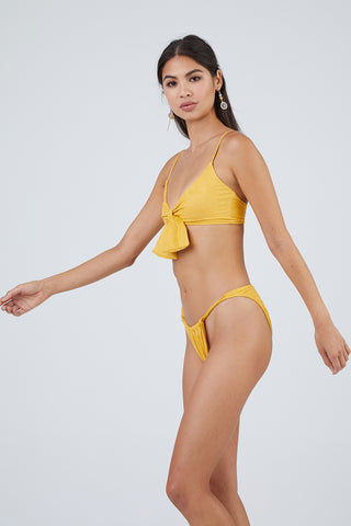 MONICA HANSEN BEACHWEAR Start Me Up Suede Front Scrunch Bikini Bottom - Yellow Bikini Bottom | Yellow| Monica Hansen Start Me Up Suede Front Scrunch Bikini Bottom - Yellow Scrunch detail in front and U shaped back High cut leg Cheeky coverage Double fabric on the inside instead of lining Italian fabric 85% Nylon 15% Elastane Manufactured in Italy Hand wash cold.  Dry flat Front View