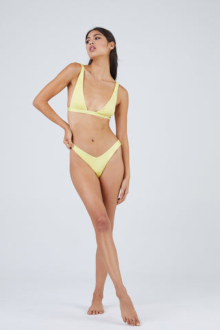 MONICA HANSEN BEACHWEAR Babe Watch Long Triangle Bikini Top - Yellow Bikini Top | Yellow| Monica Hansen Beachwear Babe Watch Long Triangle Bikini Top - Yellow Plunging U-neckline Long triangle top Small nickel colored metal clasp in back Double fabric on the inside instead of lining Italian fabric 85% Nylon 15% Elastane Manufactured in Italy Hand wash cold. Front View