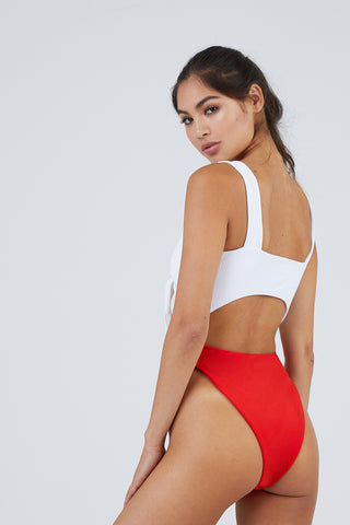 LEE + LANI High Hip Front Tie Cut Out One Piece Swimsuit - White/Red One Piece | White/Red| Lee + Lani High Hip Front Tie Cut Out One Piece Swimsuit - White/Red  Deep v neckline  Tie front closure  Thick shoulder straps Front and back cut out detail  High cut leg  Cheeky coverage Back View