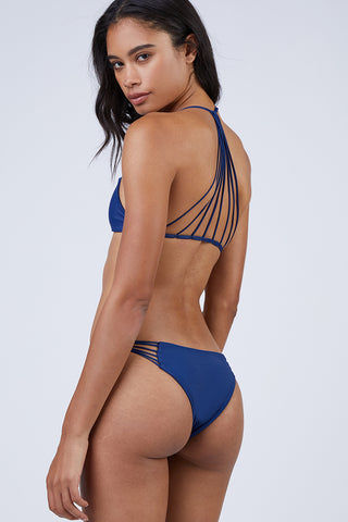 MIKOH Lanai Strappy Cheeky Bikini Bottom - Coastal Blue Bikini Bottom | Coastal Blue| Mikoh Lanai Bikini Bottom Back View Low-Rise Bikini Bottom Multi-Sting side Straps Cheeky Rear Coverage Double Lined Seamless Hardware-Free